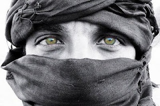 """Among the Berbers in North Africa and the Tuareq in West Africa, the women do not wear veils but the men do. The Tuareq men wear veils to protect from evil spirits (or desert sand in reality) and start to wear them at the age of 25."""