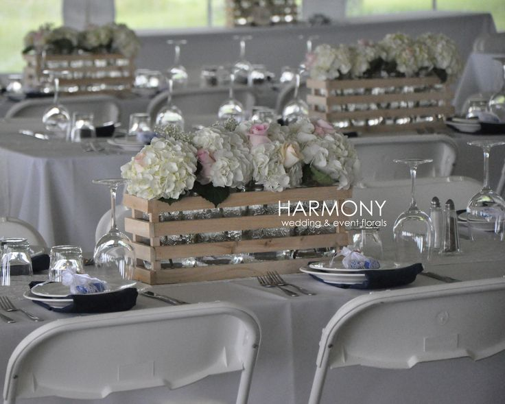 Rustic handcrafted crates with hydrangeas and roses