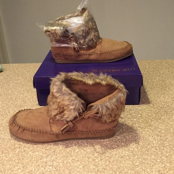 Final Sale! NWT Madden Girl Boots NWT Madden Girl Boots. Size:9m. Cabin Chic pull on moccasin style flat boot. Color is brown more like a chestnut brown. Multi colored faux fur with wrap around self tassel  tie one on each boot. So comfortable & soft. All man made materials. NO TRADES. PRICE FIRM. Madden Girl Shoes Ankle Boots & Booties