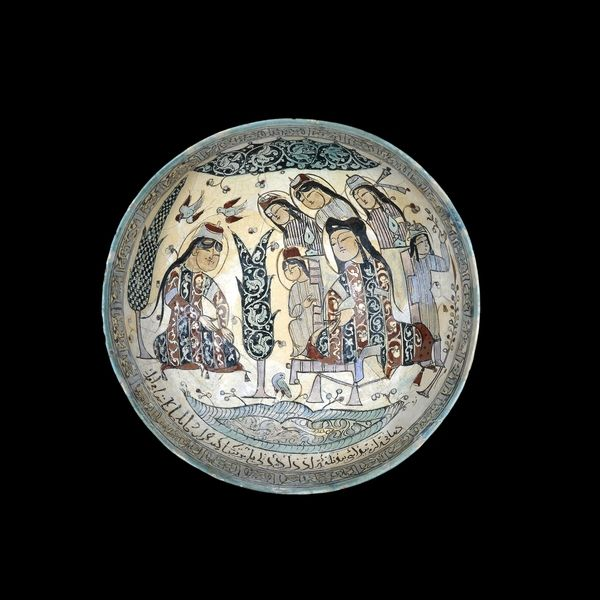 Fritware bowl, painted with an enthroned ruler and his attendants  From Kashan, Iran AD 1187