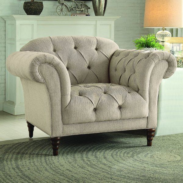 Graceful curves are elegantly appointed in this collection. Delicate herringbone style fabric presents as the initial look into the traditional style of this seating group with prevalent button-tufted accenting that is hard to overlook. The rolled arms and bowed seatbacks present an air of femininity while lending curvaceous inspiration to the traditional chaise lounge. Cherry finished turn legs provide support and complement the brown tone of the fabric.