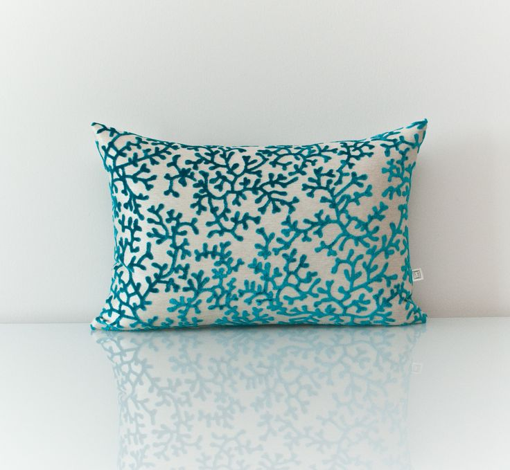 Blue Pillow available at threadsandmore.ca An opulent coral pattern pillow that intelligently uses the awe of turquoise color on a beige base. Makes an exceptional accent in a sea-inspired décor. FREE customization available (more colors available)