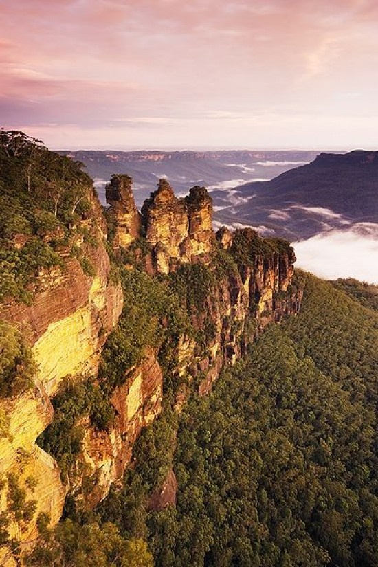 Three Sisters in Katoomba, NSW. There is nothing like standing at Echo Point and watch the amazing color of the sun as it sets over the Three Sisters. I challenge you climb the 700 steps and take the steepest railroad.