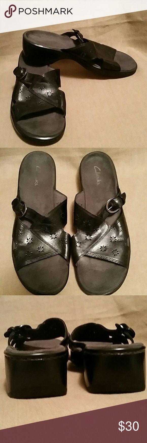EUC Clarks sandals black leather laser cut  comfy Leather upper, balance man made materials.   Buckle makes them adjustable.  Laser cutout design.  Size is 11M....medium width. Clarks Shoes Sandals
