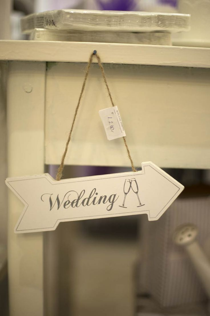 Wood arrow with wedding signed