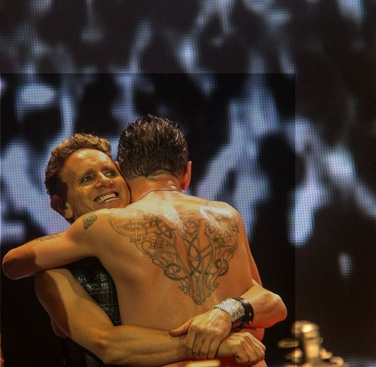 Dave Gahan hugging Martin Gore of Depeche Mode and showing ...