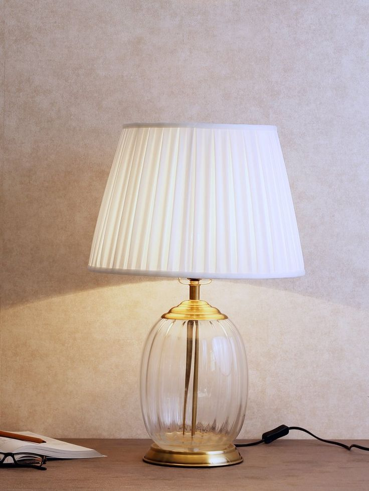 Morton give your home a touch of modern class with this crystal brass table lamp