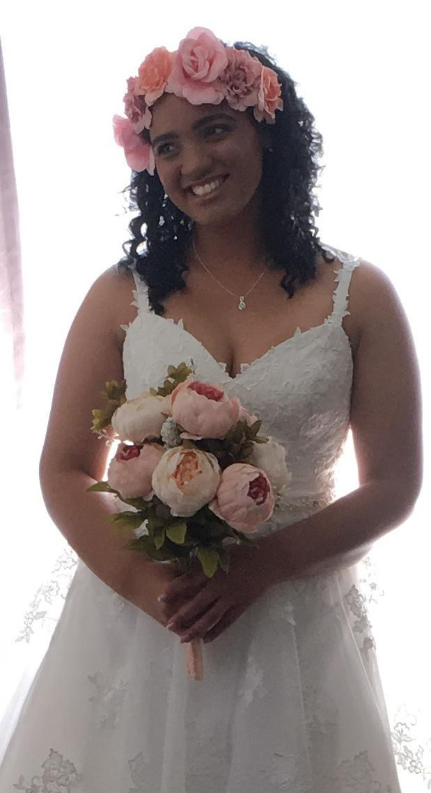 Thank you Megan for sharing this shot of your daughter wearing Bridal and Ball BB1444. She looks so happy and beautiful!