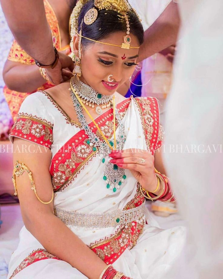 Telugu,south indian bride in bhargavi kunam's customised talambrala white saree with red border.