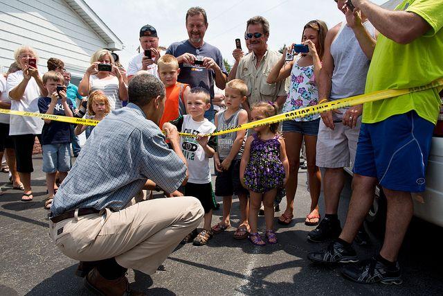 President Barack Obama talks with people outside Kozy Corners restaurant in Oak Harbor, Ohio, July 5, 2012