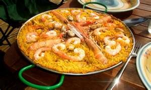 A rice dish with meat, fish, and fresh vegetables added in called Paella.
