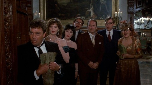 "The seven ""Clue"" leads (Tim Curry, Lesley Ann Warren, Madeline Kahn, Christopher Lloyd, Martin Mull, Michael McKean, and Eileen Brennan) try..."