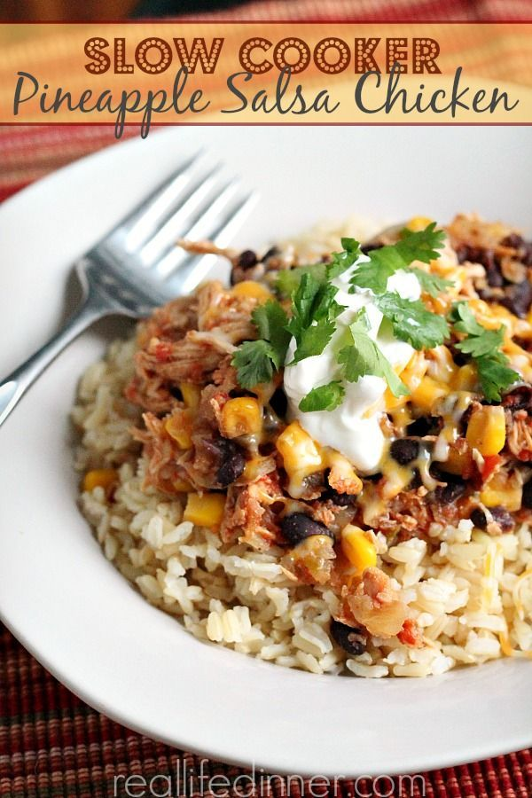 Slow Cooker Pineapple Salsa Chicken aka Mexican Delight...I can't get enough of this! The flavor is amazing! reallifedinner.com
