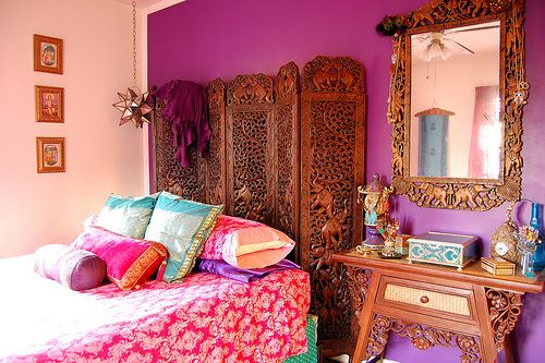 Bright bohemian bedroom with stunning hand-carved mirror, side table and room divider come bed head. Love the gorgeous Indian bed linen too.
