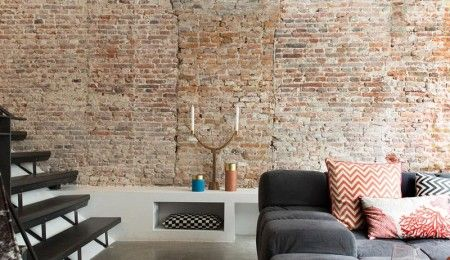 Industrial home with brick wall and concrete floor, design by BNLA architecten, photography by Jansje Klazinga.