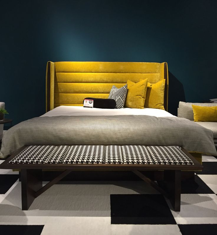 Gorgeous horizontal channel tufted headboard in a rich mustard yellow velvet and classic black and white houndstooth bedding.   #hpmkt #nathananthony #upholstery #interiordesign #fabric #interiordesign #greenhousefabrics