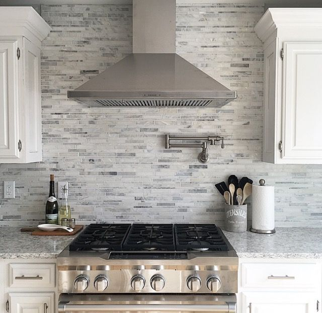 Stainless Steel Hood And Range With Marble Backsplash Quartz Counters And White Kitchen C Replacing Kitchen Countertops Kitchen Remodel Kitchen Cabinets Decor