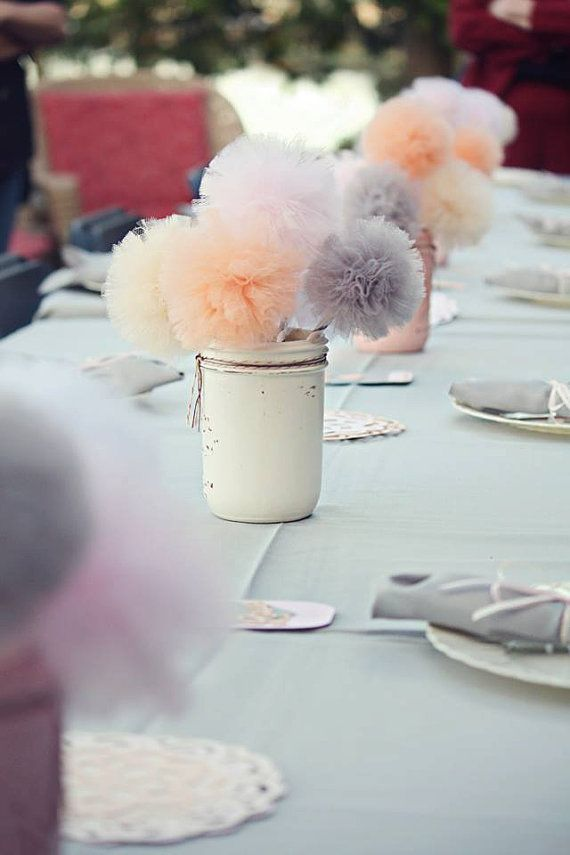 Maybe not in a mason jar but I like the mini-poms ..........Mason Jar Tulle Pom Pom Centerpiece, Wedding Decoration | www.bridebubble.co.uk |The ultimate wedding & style blog