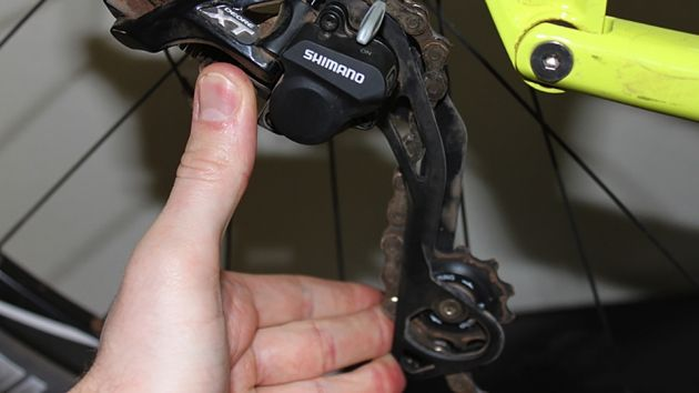 Test the amount of force required to move the derailleur cage; resistance should be firm and consistent