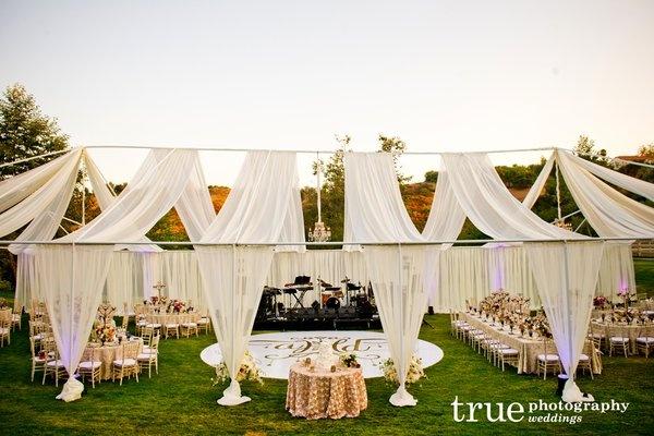 Custom tent and dance floor decor