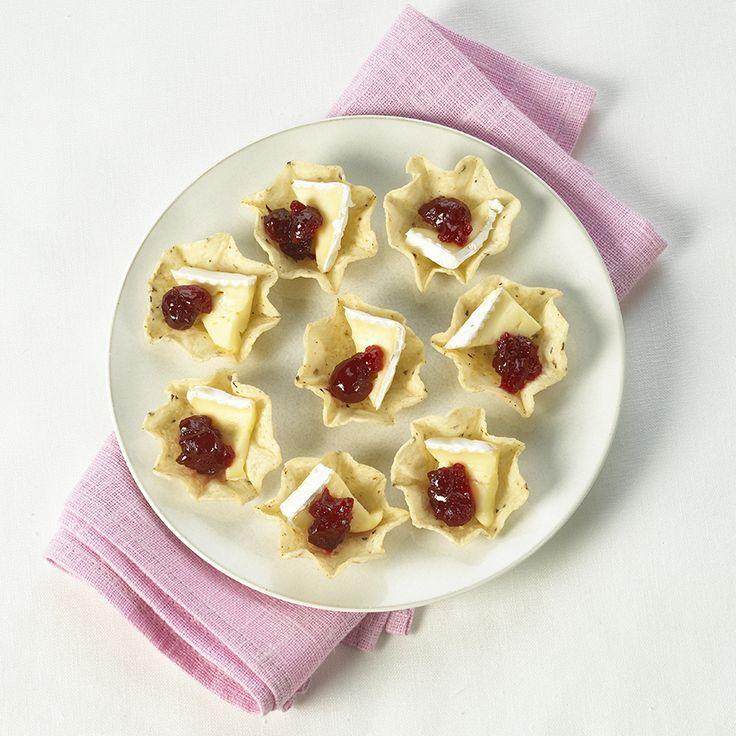 Bouchées de Brie sauce canneberges - Créez la plus savoureuse recette de Bouchées de Brie sauce canneberges. Tostitos® possède avec des directives étape par étape. Concoctez la meilleure/le meilleur pour n'importe quelle occasion.
