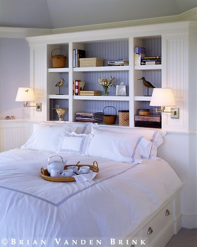 Design: love this book case over bed with lights