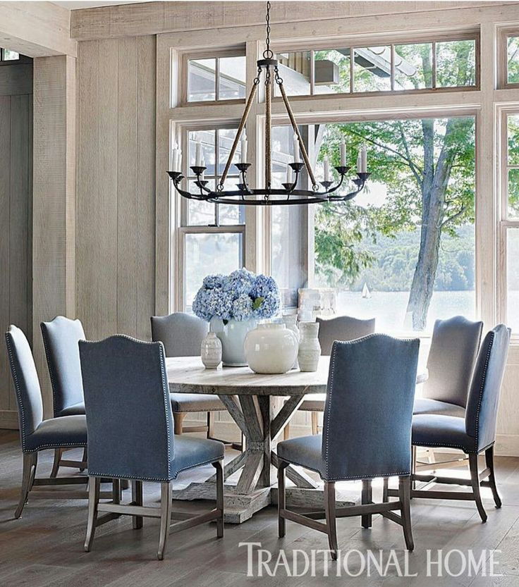 A Lola Chandelier From Bungalow Classic Hangs Above The Round Elm Dining Table Floors Throughout First Level Are Wide Plank Oak
