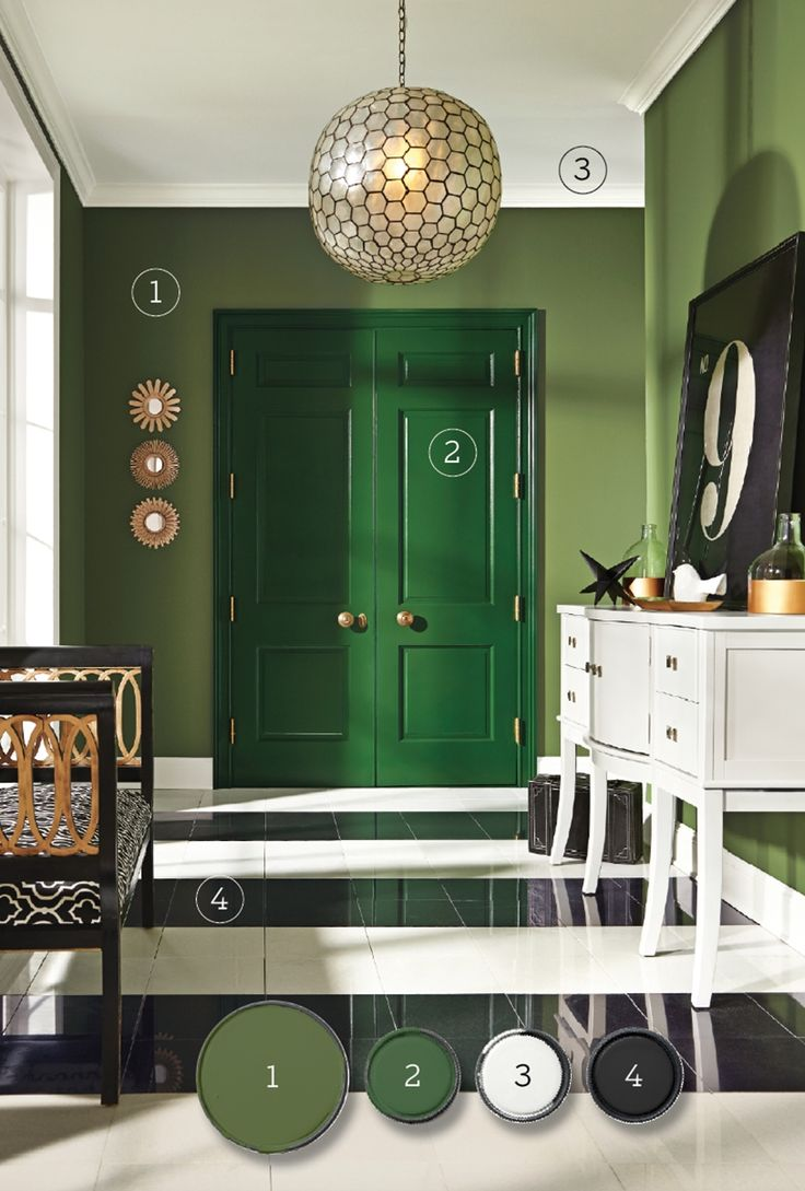 Rich green double doors, a lighter, leafy green on the surrounding walls, and stark white accents create a lush, energizing hallway. Arugula on the doors, Garden Spot on the walls; Sherwin-Williams