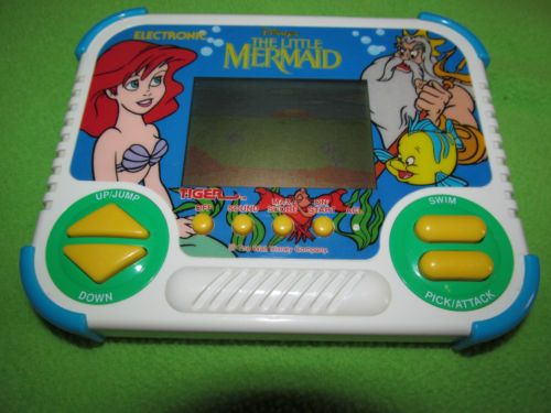 Tiger Electronics The Little Mermaid Game (1990) I totally used to have this game!!!!!!! I wish I still did!!!!