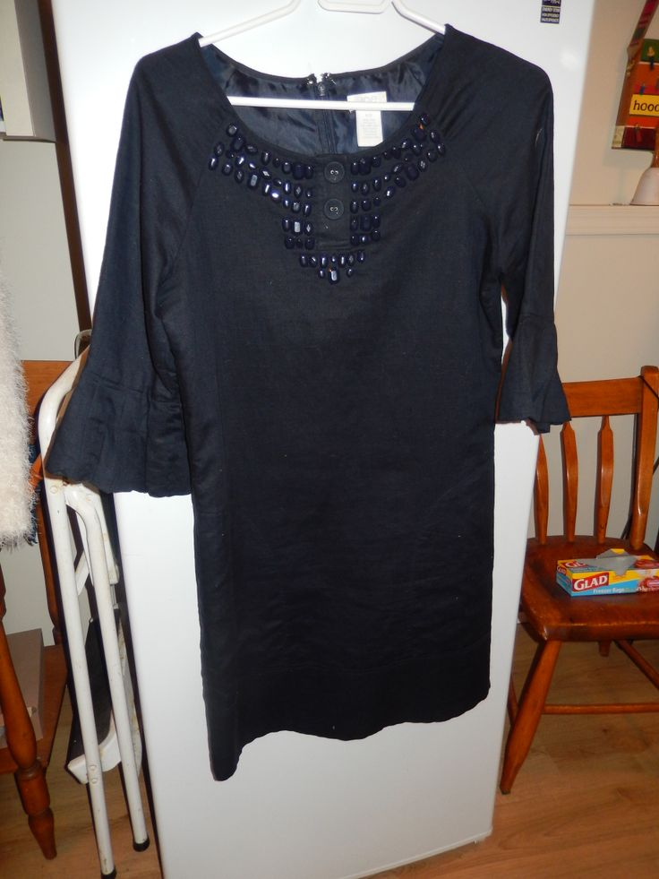 This little black dress is cute and it can be work with black tights or regular hose