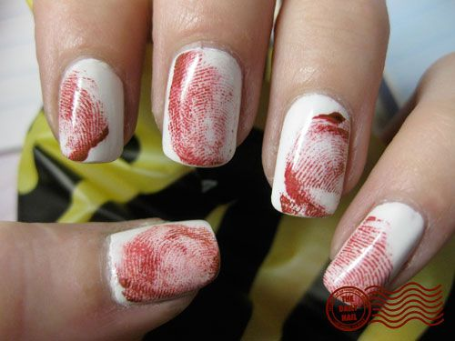 Feeling extra gutsy this Halloween? This bloody fingerprint mani will freak out all your friends. See more at The Daily Nail Blog »