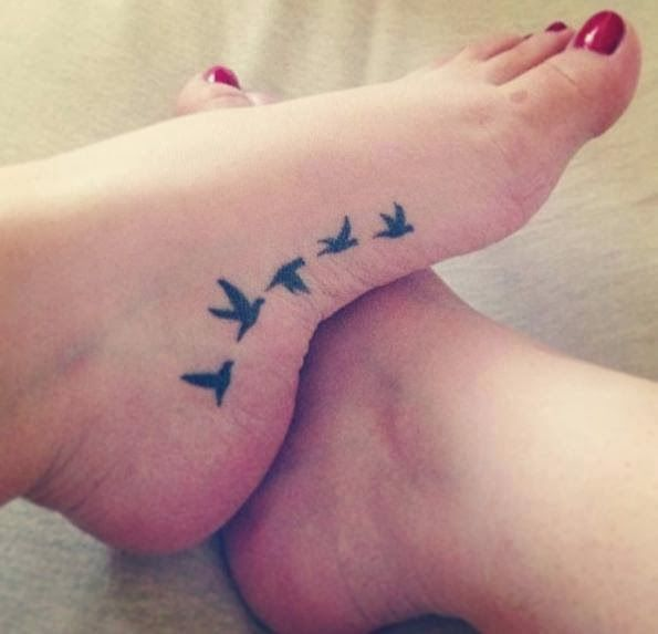 Adorable flying black ink birds tattoo on feet