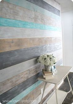 DIY painted plank wall. Simple and inexpensive - the only wood you need is a few sheets of plywood! Looks like shiplap for a farmhouse style look.