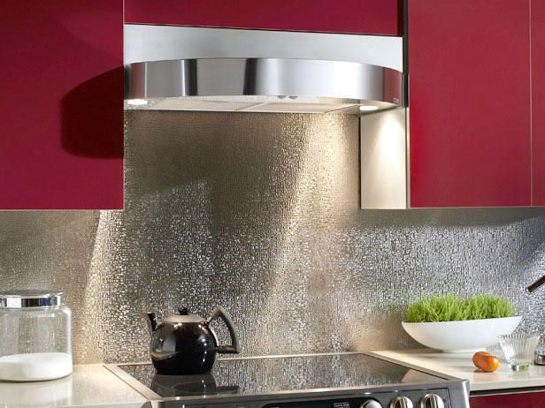 stainless backsplashes cobblestone-kind of loving this for our kitchen! In mad search of cool back splashes, this might be the one.