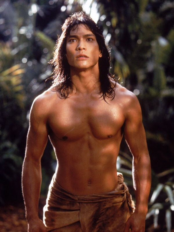 I liked the 1994 live action Jungle Book better than the animated film. You got your bare-chested Jason Scott Lee as a Mowgli who can handle the jungle, thank you very much, doesn't need to meet some girl stocking up on water to lure him into the man village!