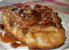 Caramel Rolls! This is my awesome easy Ice Cream Caramel Pecan Roll Recipe! Using frozen cinnamon roll dough shortcuts this recipe. The butter, sugars, pecans and ice cream mixture that's baked with them makes them gooey-rich.