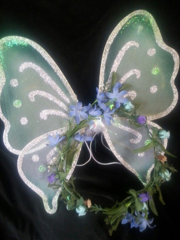 DELPHINIUM - Fairy unmentioned in Tatania's royal entourage,  featured in Shakespeare's Midsummer's Night comedy.   OOAK childs size wreath of delicate blue flowers  and handpainted wings to complement.  $25