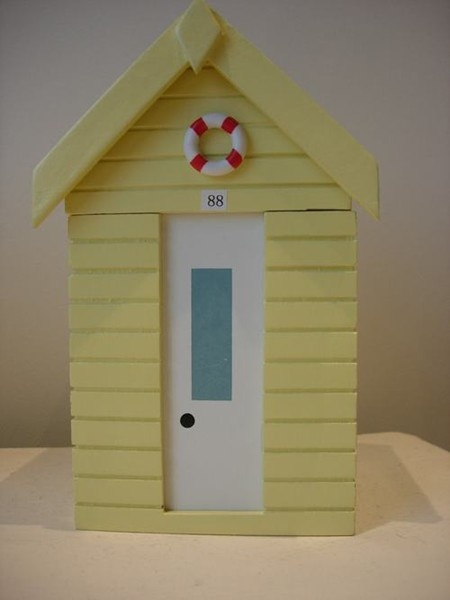 yellow beach hut wooden storage box