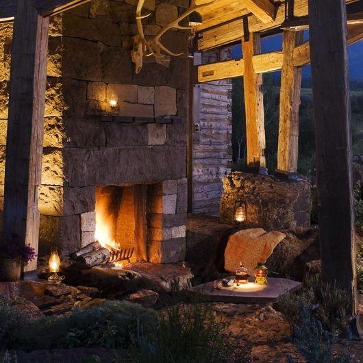 rustic outdoor fireplace area