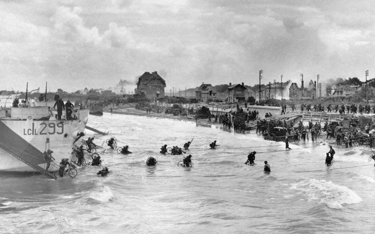 Canadian soldiers from 9th Brigade land with their bicycles at Juno Beach in Bernieres-sur-Mer during D-Day while Allied forces are storming the Normandy beaches.