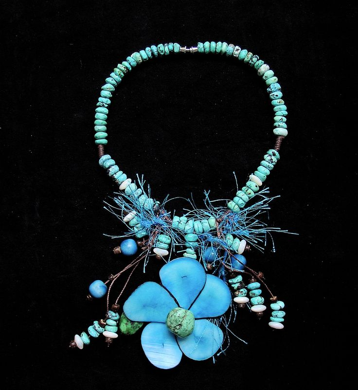 This necklace is part of the Orinoco collection which is based on the indigenous people of the Orinoco river in Venezuela.  #ethnic #necklace #fashion #flowers #seeds #orinoco #indigenous #accessories #fashionforward #fashiondesign #unique #venezuela #colombia #timelessfashion #design
