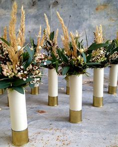 WEDDING FLOWER TUTORIALS: http://www.wedding-flowers-and-reception-ideas.com/make-your-own-wedding.html     Shot gun shell boutonnieres