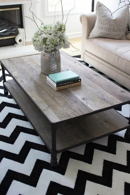 The mix of industrial chic with the bold chevron carpet makes for a knockout lounge interior. Very stylish!