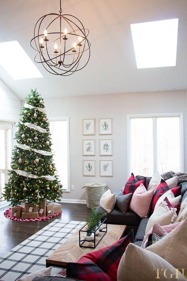 Christmas decorating ideas for your living room with grey sofa and vaulted ceiling #christmaslivingroomideas #christmastreedecorating #christmasthrowpillows
