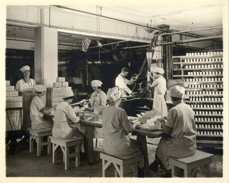 J.R. Watkins Co. workers wrapping bars of soap. Junior