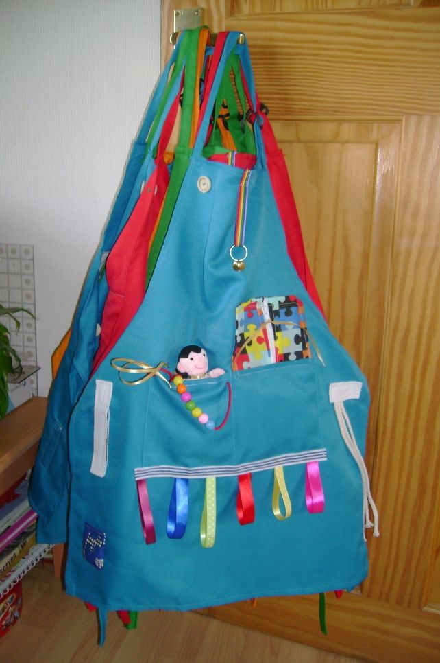 Activity Apron for challenged  children  Autism, Adhd Cerebral palsy etc £18.95