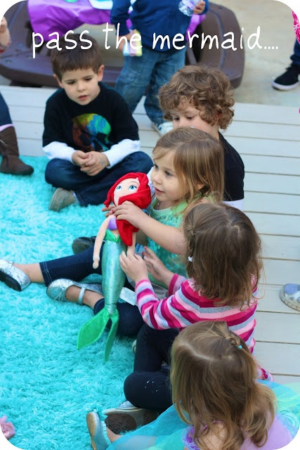 Pass the mermaid game. When the music stops the kid holding the mermaid gets their hand stamped! Cute and easy party game!