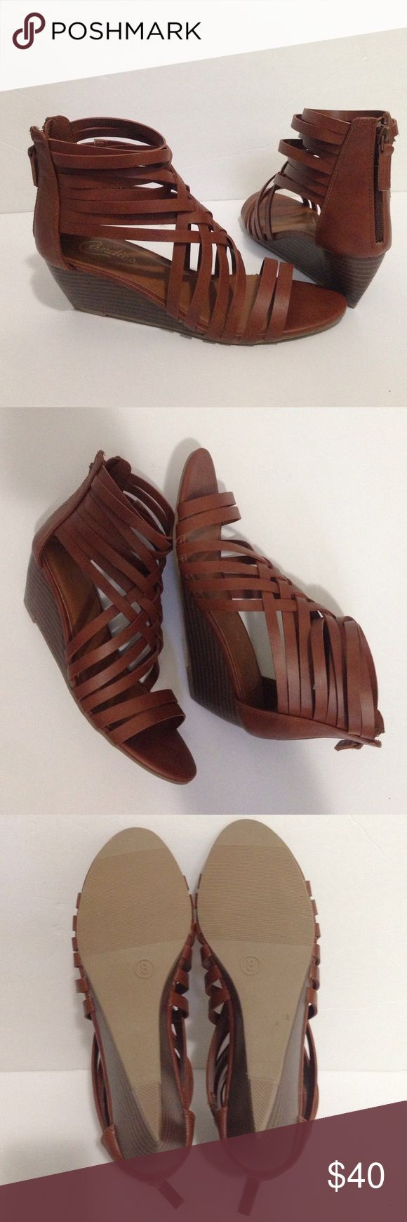 NEW IN BOX Candies Brown Wedge Sandals Candies Brown Wedge Sandals NWT Size 8. Great with dresses or jeans! Very versatile and comfortable shoe! New with box! Candie's Shoes