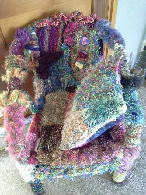 Yarn bombed cane chair with cushion by Kath Cole 2016