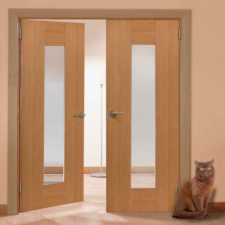 Jbk Symmetry Axis Oak Door Pair with Clear Safety Glass is fully decorated and is well priced unusual door pair ready to fit. #simplemoderndoor #woodenmoderndoorpair #frenchdoors
